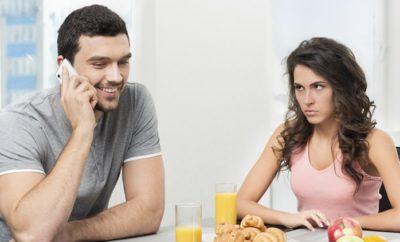 couple having breakfast, guy talking on the phone